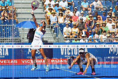 Stock Image of Spanin's padel players Marta Ortega (L) and Marta Marrero (R) in action during their Cervezas Victoria Mijas Padel Open 2019 semifinal match against Ana Nogueira and Paula Josemaria at Cala de Mijas fair center in Malaga, Andalusia, Spain, 10 August 2019.