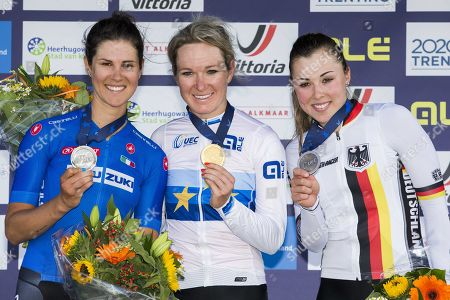 Dutch winner Amy Pieters in the midst of Elena Cecchini (Italt, L, second) and Lisa Klein (Germany, third) during the podium ceremony of the elite women's road race at the European Cycling Championship in Alkmaar, The Netherlands, 10 August, 2019.