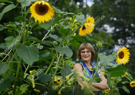 Karen Breda poses for a photograph in a garden in West Hartford, Conn. Breda attended Woodstock to see a music concert that included the Who, Jimi Hendrix, Jefferson Airplane and Crosby, Stills, Nash & Young in the lineup