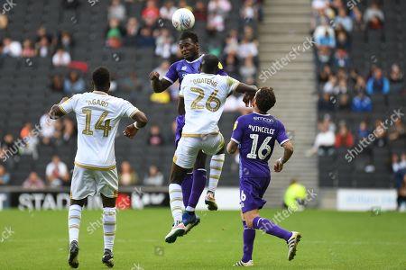 Shrewsbury Town defender Aaron Pierre (2) heads the ball  under pressure from Milton Keynes Dons midfielder Hiram Boateng (26) during the EFL Sky Bet League 1 match between Milton Keynes Dons and Shrewsbury Town at stadium:mk, Milton Keynes