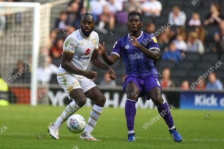 Milton Keynes Dons midfielder Hiram Boateng (26) battles for possession  with Shrewsbury Town defender Aaron Pierre (2) during the EFL Sky Bet League 1 match between Milton Keynes Dons and Shrewsbury Town at stadium:mk, Milton Keynes