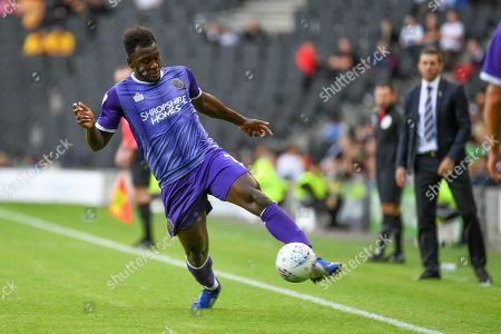 Shrewsbury Town defender Aaron Pierre (2) keeps the ball in play watched by Shrewsbury Town manager Sam Ricketts during the EFL Sky Bet League 1 match between Milton Keynes Dons and Shrewsbury Town at stadium:mk, Milton Keynes