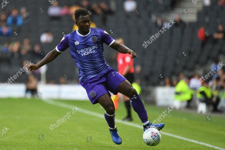 Shrewsbury Town defender Aaron Pierre (2) sprints forward with the ball during the EFL Sky Bet League 1 match between Milton Keynes Dons and Shrewsbury Town at stadium:mk, Milton Keynes