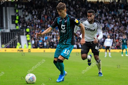 Bersant Celina of Swansea City (left) in action with Tom Huddlestone of Derby County