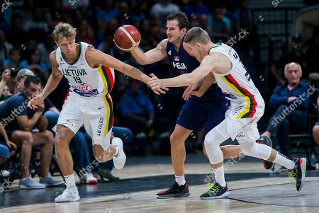 Nemanja Bjelica of Serbia competes against Mindaugas Kuzminskas of Lithuania