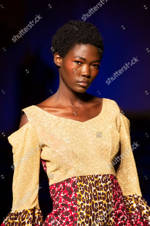Stock Picture of Model on the catwalk showcases ' Queen Diambi Kabatusuila of Kasai Kingdom Collection'