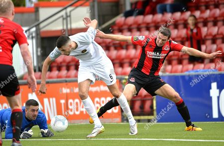 Crusaders v Carrick Rangers. Crusaders Gary Thompson in action with Carricks Caolan Loughran