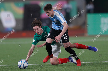 Stock Image of Facundo Waller of Uruguay, right, controls the ball under pressure from Marcel Ruiz of Mexico, during the men's bronze medal soccer match at the Pan American Games in Lima, Peru