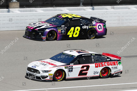 Brad Keselowski (2) and Jimmie Johnson (48) practice for a NASCAR Cup Series auto race at Michigan International Speedway in Brooklyn, Mich