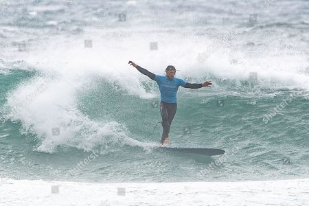 Ben Skinner (UK) stylishly 'walks the board' during the Boardmasters Longboard Pro at Fistral Beach, Newquay, Cornwall