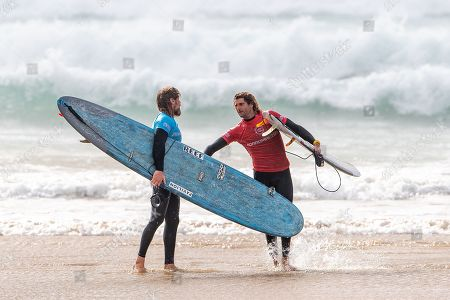 Stock Picture of Ben Skinner (UK) and Frederico Nesti (ITA) congratulate each other on a tough heat. Nesti beat Skinner by the slimmest of margins to progress to the next round of the Boardmasters Longboard Pro at Fistral Beach, Newquay, Cornwall