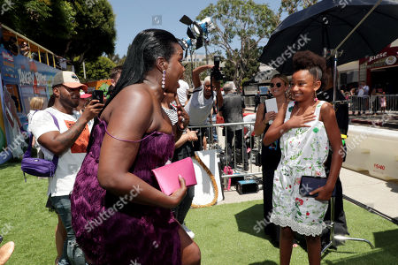Leslie Jones and Genesis Tennon at the Premiere of Columbia Pictures and Rovio Animations 'The Angry Birds Movie 2' at Regency Village Theatre, in theaters Tuesday, August 13'