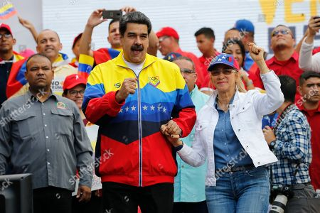 Nicolas Maduro, Cilia Flores. Venezuela's President Nicolas Maduro, center, and first lady Cilia Flores, lead a rally condemning the economic sanctions imposed by the administration of U.S. President Donald Trump on Venezuela, in Caracas, Venezuela, . Supporters of Maduro joined him after he called for protests against the fresh moves by the U.S. to tighten sanctions against the ruling authorities