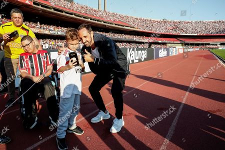 Spanish soccer player Juanfran Torres appears before the fans of Sao Paulo FC at the grass of the Morumbi stadium in Sao Paulo, Brazil, on 10 August 2019, before the match for the Brazilian league between Sao Paulo and Santos. Sao Paulo, one of the historical teams of Brazil, announced the hiring of Juanfran on 03 August, two days after that of the midfielder Daniel Alves.