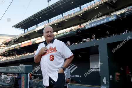 Stock Image of Former Baltimore Orioles infielder Cal Ripken, Jr. waits to be introduced during a ceremony honoring the 1989 team prior to a baseball game against the Houston Astros, in Baltimore