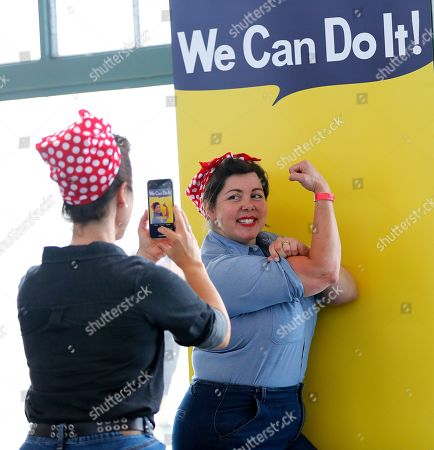 Stock Image of Lynn Schwab (R) and Sarah Morgan (L) participate in celebrating the legacy of Rosie the Riveter at the Rosie Rally Home Front Festival at the The Rosie the Riveter / WWII Home Front National Historical Park in Richmond, California, USA, 10 August 2019. 'Rosie the Riveter', a character from a Westinghouse propaganda poster was used to recruit women in the workplace to help during the WWII efforts.