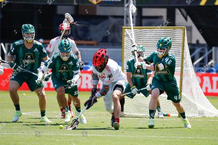 Stock Photo of The Chaos' Connor Fields, center, fights for the ball during a Premier Lacrosse League game on in San Jose, Calif