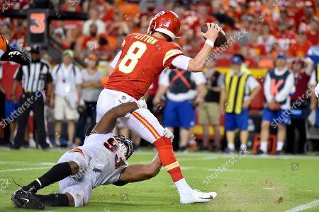 Cincinnati Bengals defensive end Andrew Brown (93) sacks Kansas City Chiefs quarterback Chase Litton (8) during the second half of an NFL preseason football game in Kansas City, Mo
