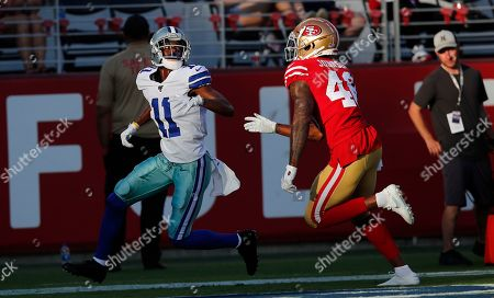Stock Picture of Dallas Cowboys wide receiver Reggie Davis (11) is guarded by San Francisco 49ers Dontae Johnson an NFL preseason football game in Santa Clara, Calif