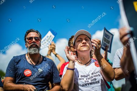 Stock Picture of Manuel Oliver and Emma Gonzalez are joined by members of the community to protest Walmart's continued sales of guns in many of their locations. The protest was held in front of the Heron Bay Walmart in Florida. This particular Walmart is where many students took shelter after being evacuated during the mass school shooting at Marjory Stoneman Douglas High School in Parkland, Florida on 2/14/2018.