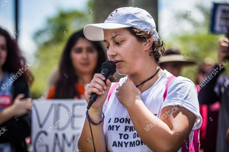 Stock Image of Emma Gonzalez of March For Our Lives gives a speech during a protest of Walmart's continued sales of guns in many of their locations. The protest was held in front of the Heron Bay Walmart in Florida.