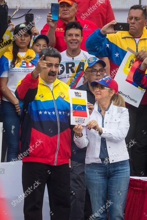 Venezuelan President Nicolas Maduro (L), along with his wife Cilia Flores (R), leads a demonstration against the sanctions that US President Donald J. Trump imposed against Venezuela; in Caracas, Venezuela, 10 August 2019.