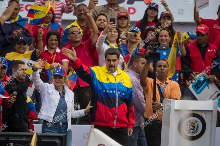 Venezuelan President Nicolas Maduro (C), along with his wife Cilia Flores (C-L), leads a demonstration against the sanctions that US President Donald J. Trump imposed against Venezuela; in Caracas, Venezuela, 10 August 2019.