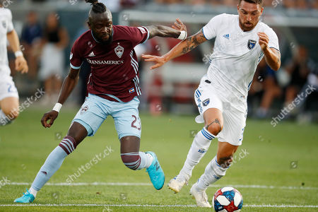 R m. Colorado Rapids forward Kei Kamara, left, fights for control of the ball with San Jose Earthquakes defender Guram Kashia in the first half of an MLS soccer match, in Commerce City, Colo
