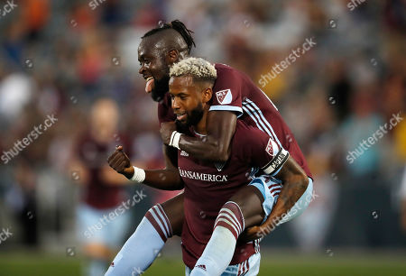 R m. Colorado Rapids forward Kei Kamara, back, jumps on midfielder Kellyn Acosta after he scored a goal against the San Jose Earthquakes in the first half of an MLS soccer match, in Commerce City, Colo