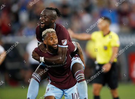 Kellyn Acosta, Kei Kamara, r m. Colorado Rapids forward Kei Kamara, top, jumps on midfielder Kellyn Acosta after he scored a goal against the San Jose Earthquakes in the first half of an MLS soccer match, in Commerce City, Colo
