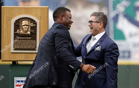 Edgar Martinez, Ken Griffey Jr. Former Seattle Mariners designated hitter Edgar Martinez, right, is greeted by former teammate Ken Griffey Jr. while Martinez was being honored for his recent induction into the Baseball Hall of Fame, before a game between the Mariners and the Tampa Bay Rays, in Seattle