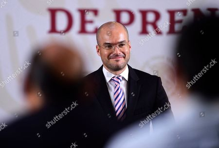 In this handout photo provided by Mexico's Presidential Press Office, David Leon, national coordinator of Civil Protection, attends the daily press briefing at the National Palace in Mexico City, Mexico