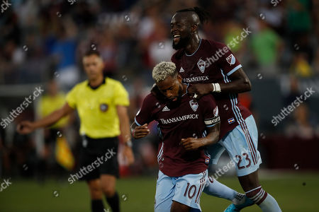R m. Colorado Rapids midfielder Kellyn Acosta (10) and Colorado Rapids forward Kei Kamara (23) celebrate after Acosta's goal against the San Jose Earthquakes in the first half of an MLS soccer match, in Commerce City, Colo