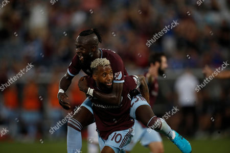 R m. Colorado Rapids midfielder Kellyn Acosta (10) celebrates his goal with Colorado Rapids forward Kei Kamara (23) in the first half of an MLS soccer match against the San Jose Earthquakes, in Commerce City, Colo
