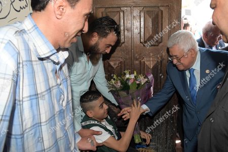 Palestinian President Mahmoud Abbas visits the Jalazone refugee camp, near the West Bank city of Ramallah