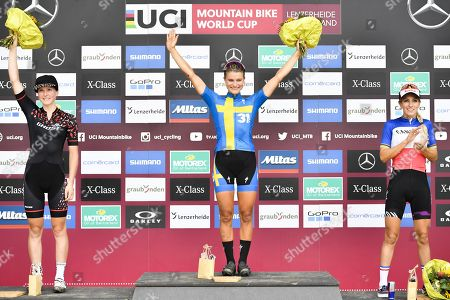 The podium with (L-R)  second placed Anne Terpstra of Netherlands, winner Jenny Rissveds of Sweden and third placed Pauline Ferrand Prevot of France after the UCI Cross Country Mountain Bike World Cup race in Lenzerheide, Switzerland, 11 August 2019.