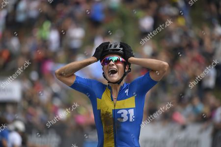 Sweden's Jenny Rissveds celebrates her win while crossing the finish line during the UCI Cross Country Mountain Bike World Cup race in Lenzerheide, Switzerland, 11 August 2019.