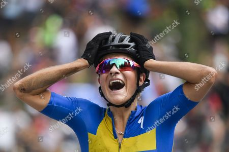 Jenny Rissveds of Sweden reacts after winning the UCI Cross Country Mountain Bike World Cup race in Lenzerheide, Switzerland, 11 August 2019.