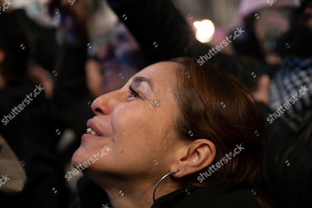 """A supporters of presidential candidate Alberto Fernandez listen to him speak outside the """"Frente de Todos"""" party headquarters after primary elections in Buenos Aires, Argentina, . The """"Frente de Todos"""" presidential ticket with former President Cristina Fernández emerged as the strongest vote-getter in Argentina's primary elections Sunday, indicating conservative President Mauricio Macri will face an uphill battle going into general elections in October"""