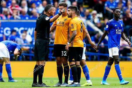 Leander Dendoncker of Wolverhampton Wanderers and Ruben Neves of Wolverhampton Wanderers argue with referee Andre Marriner