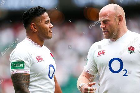 Manu Tuilagi and Dan Cole of England look on