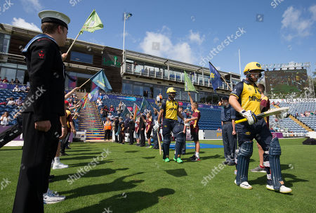 Fakhar Zaman and David Lloyd of Glamorgan head out to the wicket at the start of play