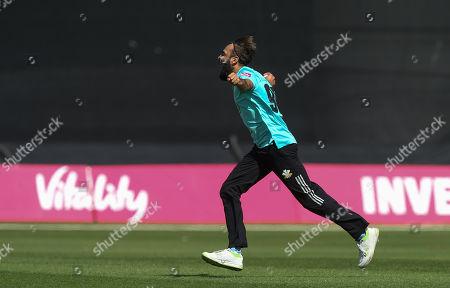 Imran Tahir of Surrey celebrates after he takes the wicket of Shaun Marsh of Glamorgan