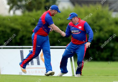 Merrion vs Clontarf. Clontarf's Conor Kelly celebrates catching David Delany with Andrew Poynter