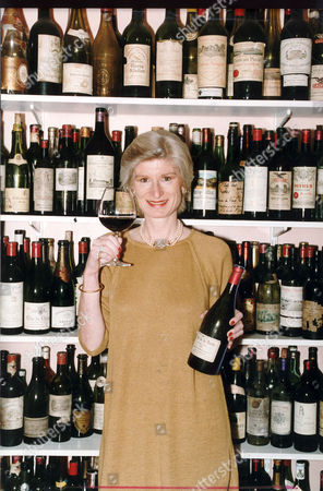 Editorial photo of Mrs Serena Sutcliffe 53.head Of Sotheby's Wine Department In Her Kitchen With Empty Bottles Of The Worlds Finest Vintage's