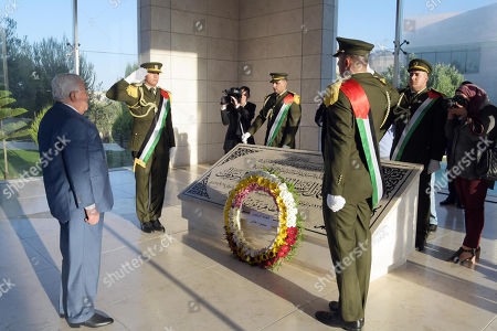 Palestinian President Mahmoud Abbas lays wreath of flower at the grave of the late Palestinian leader Yasser Arafat during the Eid al-Adha festival in the West Bank city of Ramallah