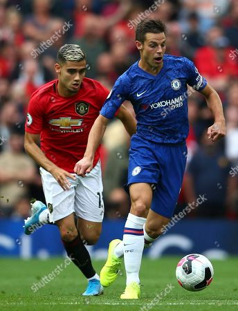 Manchester United's Andreas Pereira, left, challenges Chelsea's Cesar Azpilicueta during the English Premier League soccer match between Manchester United and Chelsea at Old Trafford in Manchester, England