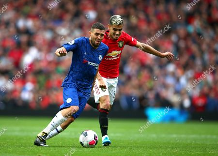 Manchester United's Andreas Pereira, right, challenges Chelsea's Mateo Kovacic during the English Premier League soccer match between Manchester United and Chelsea at Old Trafford in Manchester, England
