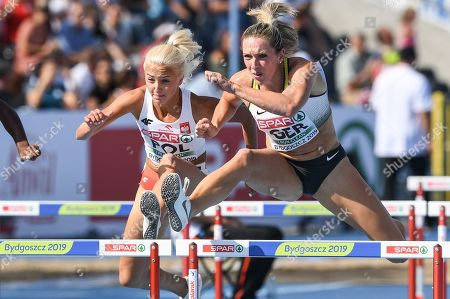 Stock Picture of Karolina Koleczek (L) of Poland and Cindy Roleder (R) of Germany compete in the women's 100m hurdles final during the European Athletics Team Championships Super League in Bydgoszcz, Poland, 11 August 2019.