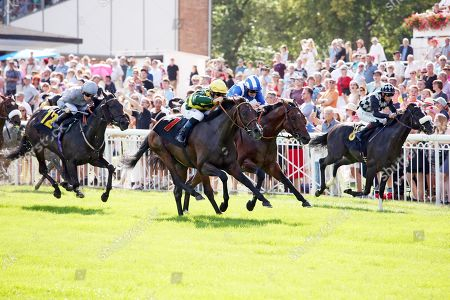 , Hoppegarten, Red Torch with Olivier Peslier (yellow cap) up wins at Hoppegarten racecourse, Germany.